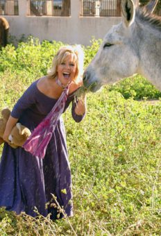Jan playing with Zanny, the burro,