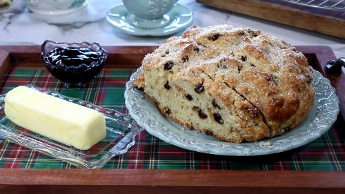Irish Soda Bread on a blue plate with butter on the side